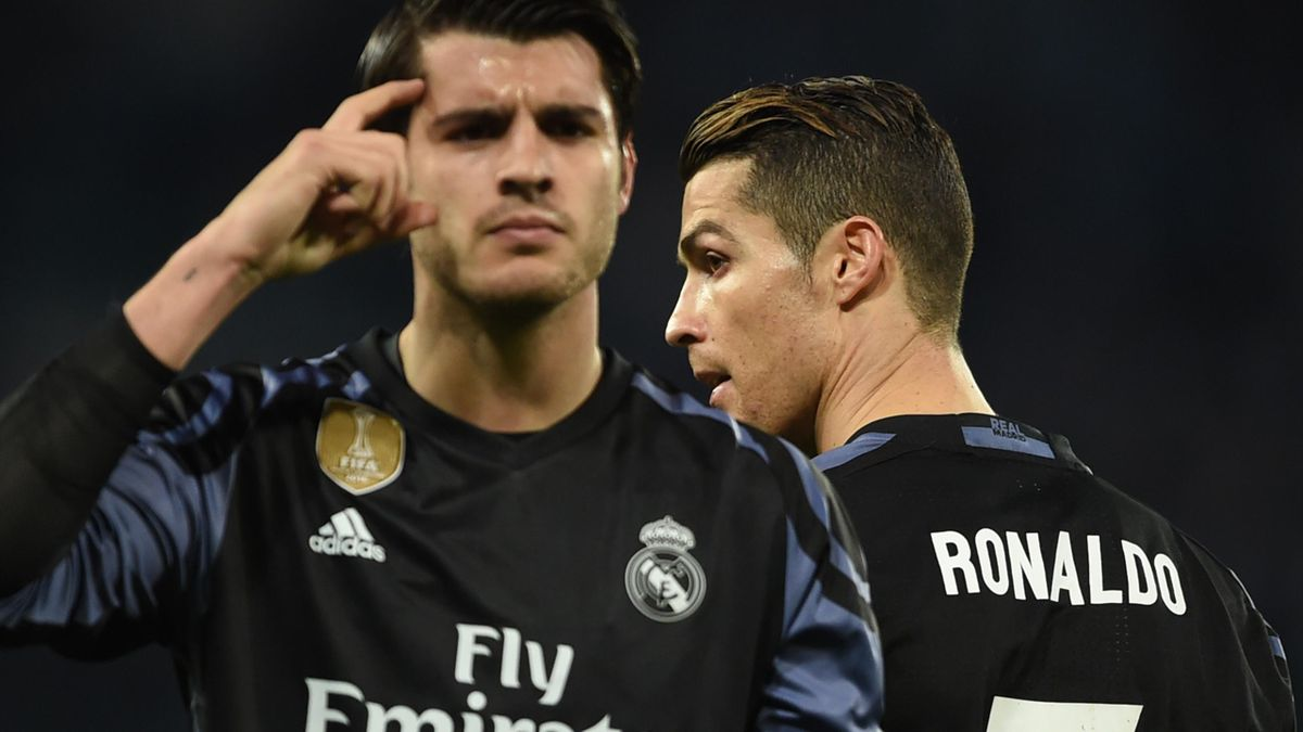 Real Madrid's forward Alvaro Morata (L) celebrates next to Real Madrid's Portuguese forward Cristiano Ronaldo