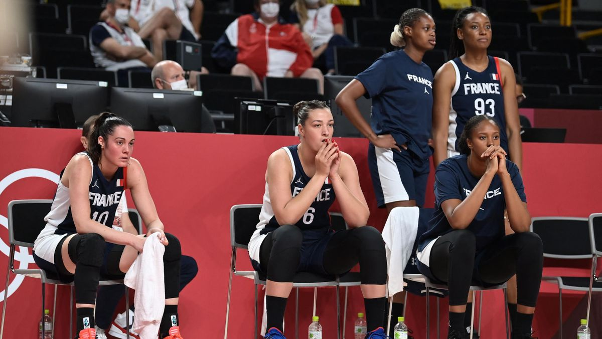 rench players watch the women's preliminary round group B basketball match between France and Japan during the Tokyo 2020 Olympic Games at the Saitama Super Arena in Saitama on July 27, 2021