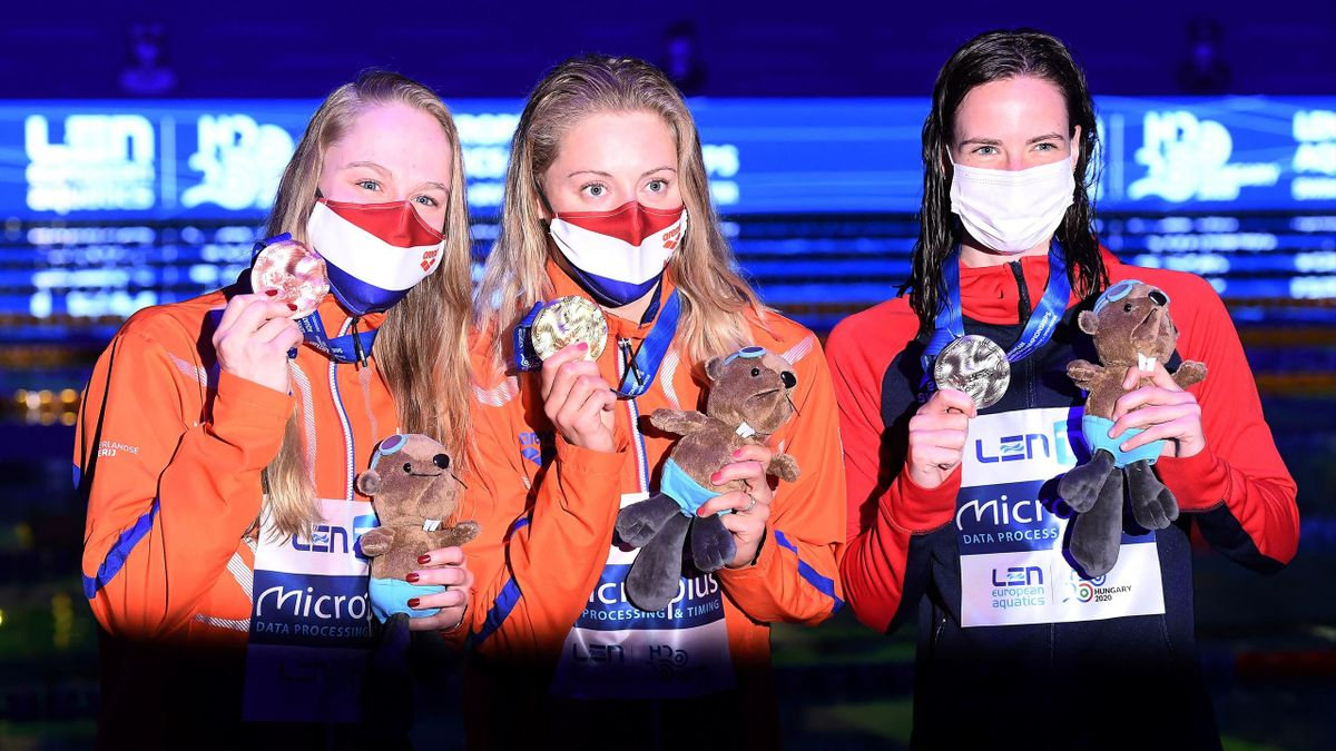 Netherlands' Kira Toussaint (C) poses with her gold medal past silver maedallist Great Britain's Kathleen Dawson (R) and bronze medallist Netherlands' Maaike De Waard on the podium of the Womens 50m Backstroke Swimming event