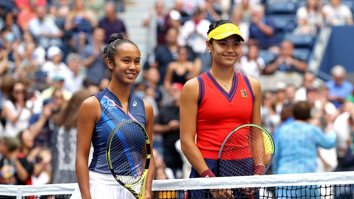 Leylah Fernandez of Canada and Emma Raducanu of Great Britain stand at center court before their Women's Singles final match on Day Thirteen of the 2021 US Open at the USTA Billie Jean King National Tennis Center