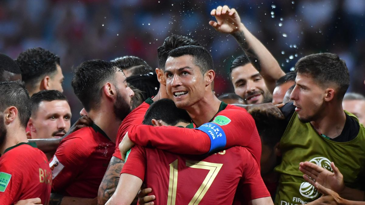 Portugal's forward Cristiano Ronaldo (C) celebrates his second goal with teammates during the Russia 2018 World Cup Group B football match between Portugal and Spain at the Fisht Stadium in Sochi on June 15, 2018