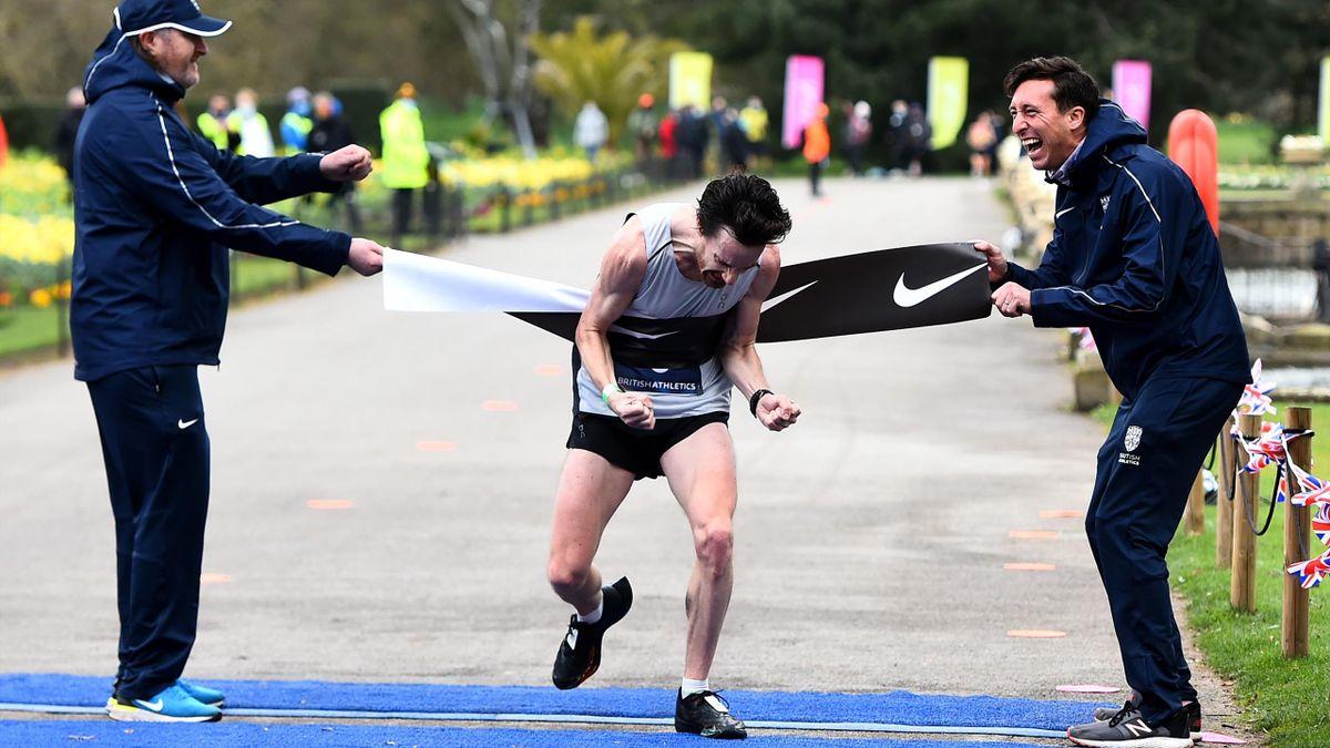 Chris Thompson celebrates winning the British marathon trials