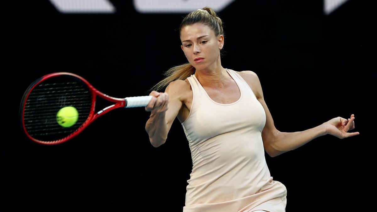 Camila Giorgi of Italy plays a forehand in her Women's Singles second round match against Iga Swiatek of Poland during day three of the 2021 Australian Open at Melbourne Park