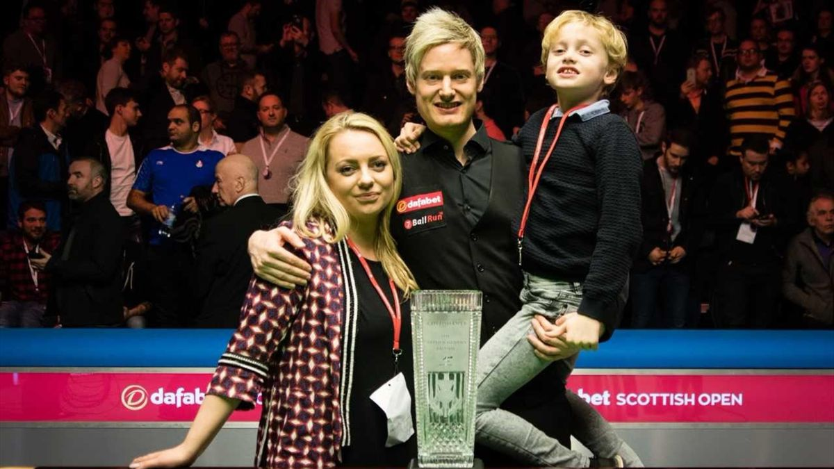 Neil Robertson celebrates with title and family.