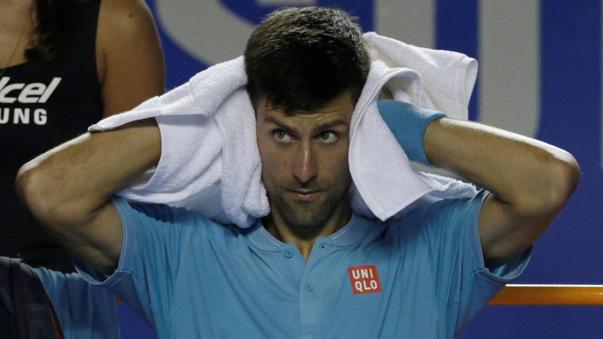 Serbia's Novak Djokovic rests during the match against Australia's Nick Kyrgios.