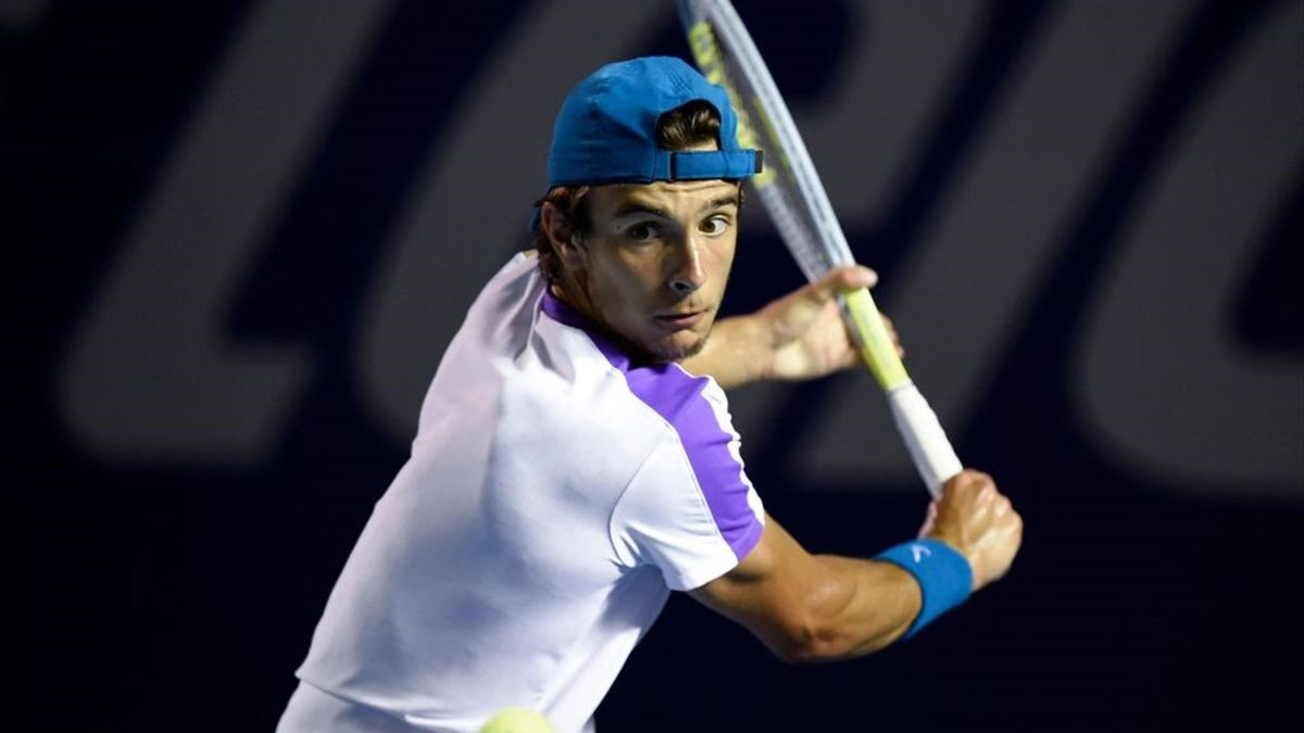 Italy's Lorenzo Musetti returns the ball to Bulgaria's Grigor Dimitrov (out frame) during their Mexico ATP Open 500 men's singles tennis match in Acapulco, Mexico, on March 18, 2021