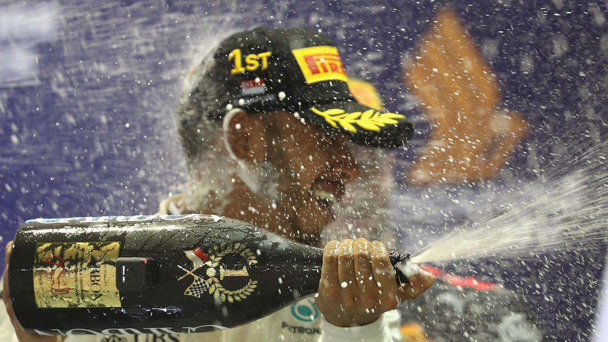 Lewis Hamilton celebrates winning the Singapore GP