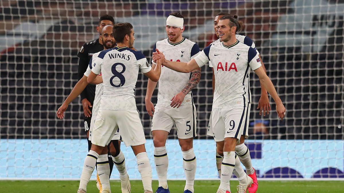 Gareth Bale of Tottenham Hotspur celebrates with Harry Winks of Tottenham Hotspur after their sides second goa