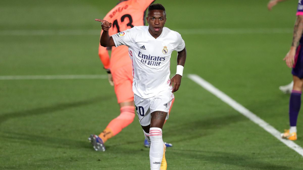 Vinicius Junior of Real Madrid celebrates after scoring his team's first goal during the La Liga Santander match between Real Madrid and Real Valladolid CF at Estadio Santiago Bernabeu on September 30, 2020 in Madrid, Spain.