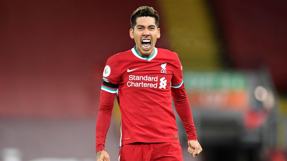 Liverpool's Brazilian midfielder Roberto Firmino celebrates scoring his team's second goal during the English Premier League football match between Liverpool and Tottenham Hotspur at Anfield in Liverpool, north west England on December 16, 2020.