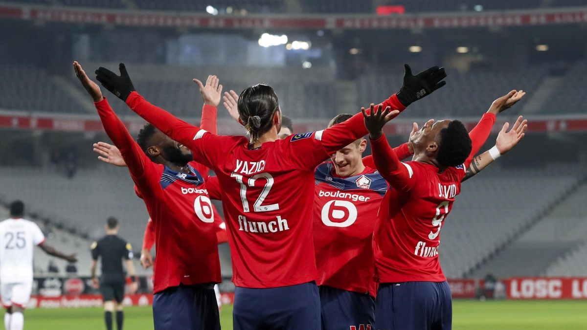 Yusuf Yazici #12 of Lille OSC celebrates his goal with Jonathan Bamba #7, Domagoj Bradaric #29 and Jonathan Christian David #9 of Lille OSC