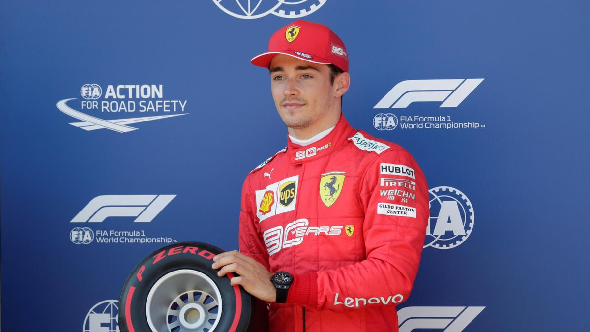 Austrian Grand Prix - Red Bull Ring, Spielberg, Austria - June 29, 2019 Ferrari's Charles Leclerc celebrates with a trophy after qualifying in pole position