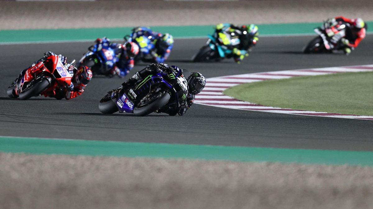 Monster Energy Yamaha MotoGP's Spanish rider Maverick Vinales (C) drives during the Moto GP Qatar Grand Prix at the Losail International Circuit, in the city of Lusail on March 28, 2021. (Photo by KARIM JAAFAR / AFP) (Photo by KARIM JAAFAR/AFP via Getty I