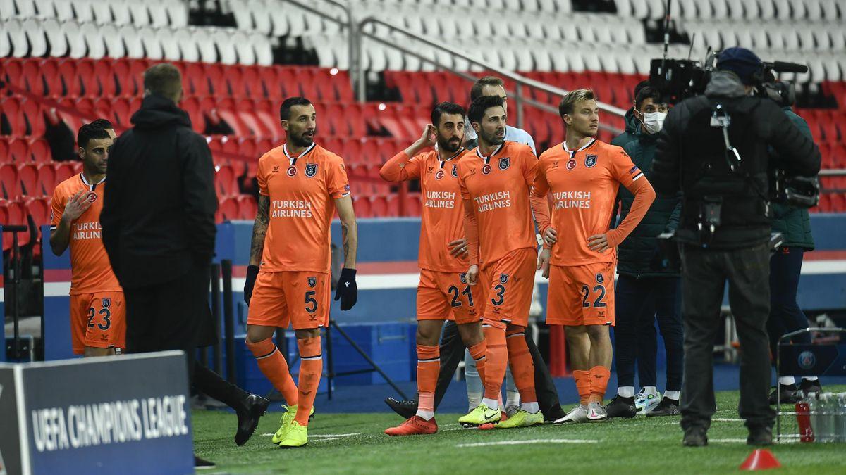 Players of Medipol Basaksehir are seen as Paris Saint Germain and Medipol Basaksehir UEFA Champions League match paused
