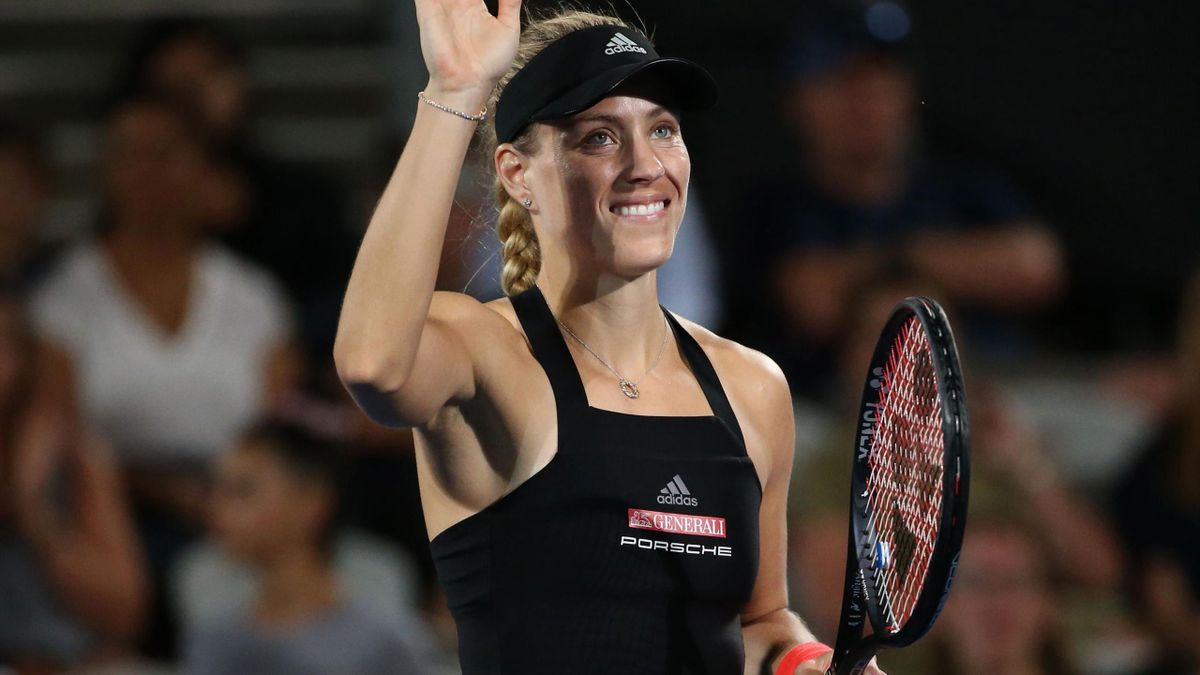 Angelique Kerber from Germany waves to the crowd after beating Camila Giorgi from Italy after their women's second round match at the Sydney International tennis tournament in Sydney.