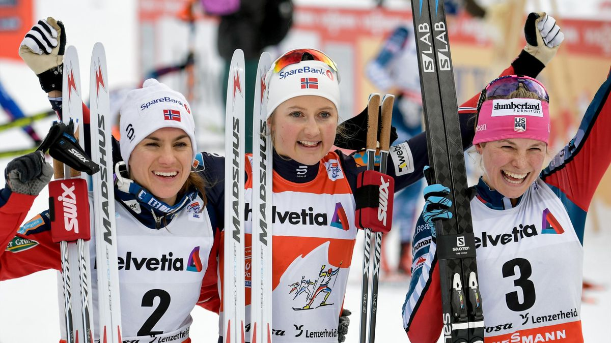 (From L) Second placed Heidi Weng of Norway, winner Ingvild Flugstad Oestberg of Norway and third placed Jessica Diggins of the US celebrate during the podium ceremony for the Women's 10 km pursuit free during the cross country FIS World cup Tour de Ski e