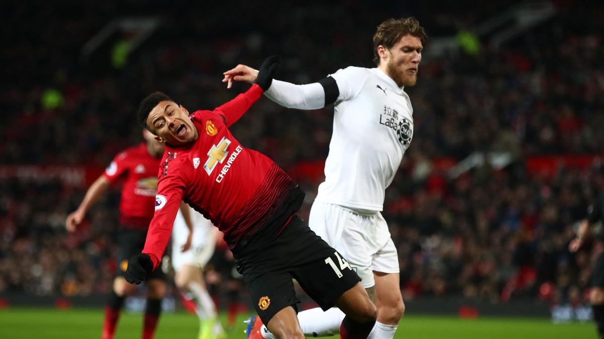 Jesse Lingard of Manchester United is challenged by Jeff Hendrick of Burnley during the Premier League match between Manchester United and Burnley at Old Trafford on January 29, 2019 in Manchester, United Kingdom.
