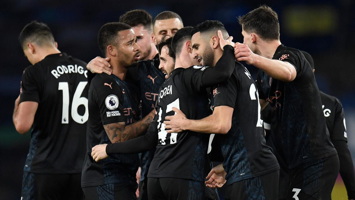 Riyad Mahrez of Manchester City is is congratulated by Phil Foden and team mates after scoring their side's second goal during the Premier League match between Everton and Manchester City at Goodison Park on February 17, 2021 in Liverpool, England