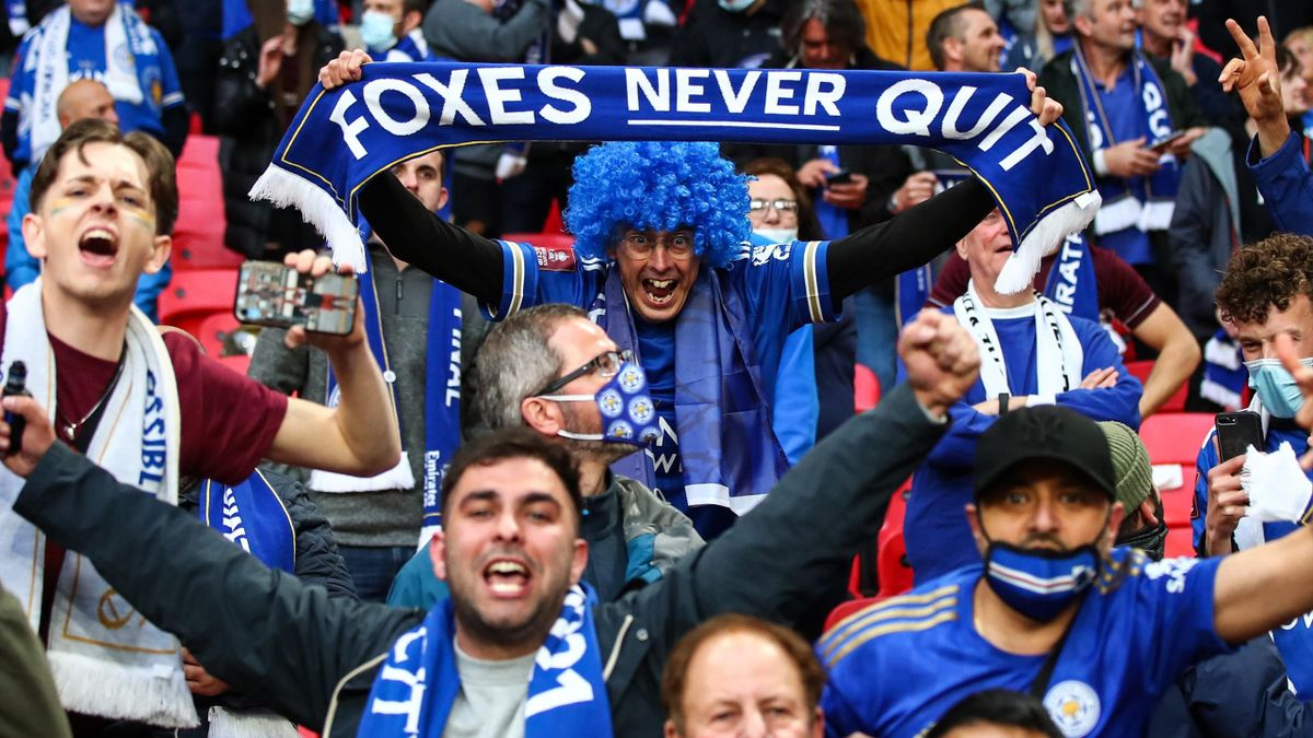 Leicester City fans celebrate the winning goal against Chelsea in the FA Cup