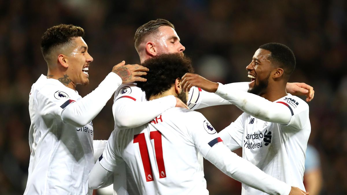 Mohamed Salah of Liverpool celebrates with teammates after scoring his team's first goal during the Premier League match between West Ham United and Liverpool FC at London Stadium on January 29, 2020 in London, United Kingdom