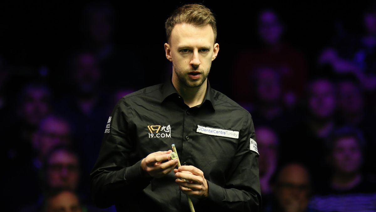 Judd Trump of England chalks the cue during the quarter-final match against Anthony Hamilton of England on day five of 2019 Northern Ireland Open at Waterfront Hall on November 15, 2019 in Belfast, Northern Ireland.