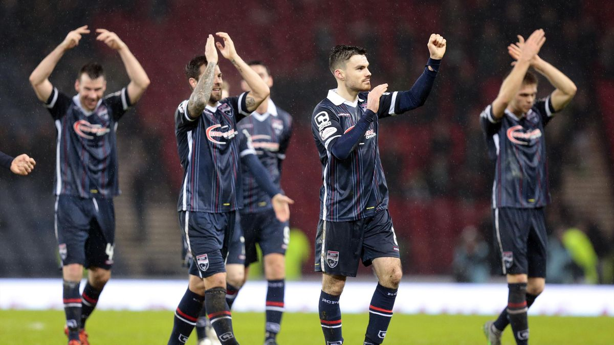 Ross County players celebrate victory over Celtic in the League Cup semi-finals