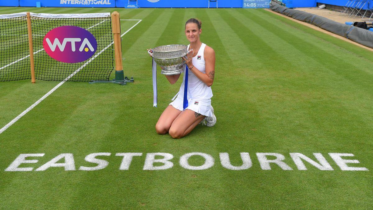 Champion Karolina Pliskova of the Czech Republic poses with the trophy following victory during the ladies singles final against Caroline Wozniacki of Denmark.