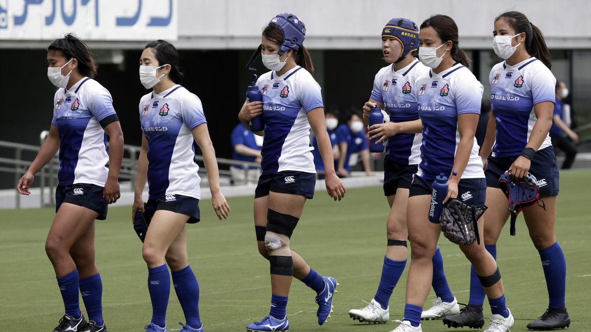 Players wear protective face masks as they leave the pitch following an operational test match for the Rugby Sevens event of the now-postponed Tokyo 2020 Olympic Games at Tokyo Stadium in Tokyo, Japan, on Thursday, April 22, 2021