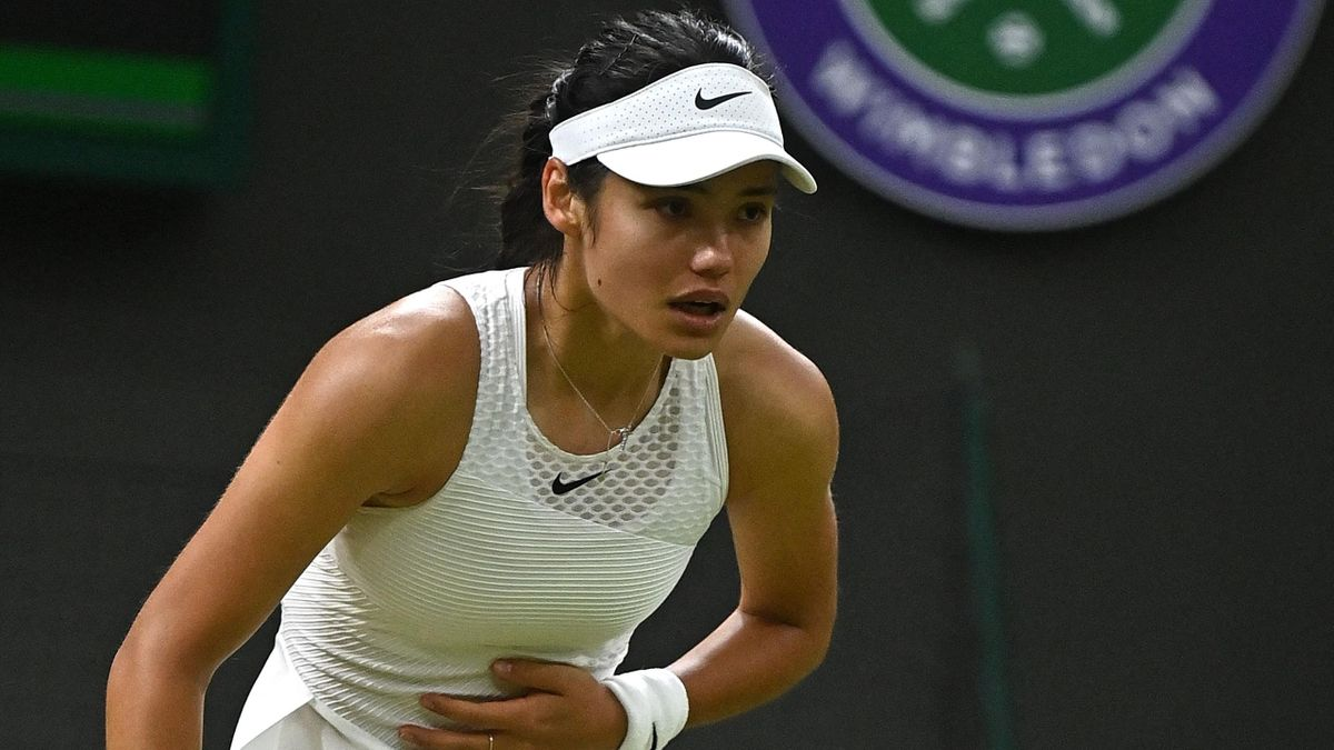 Britain's Emma Raducanu reacts during the match against Australia's Ajla Tomljanovic at their women's singles fourth round match on the seventh day of the 2021 Wimbledon Championships