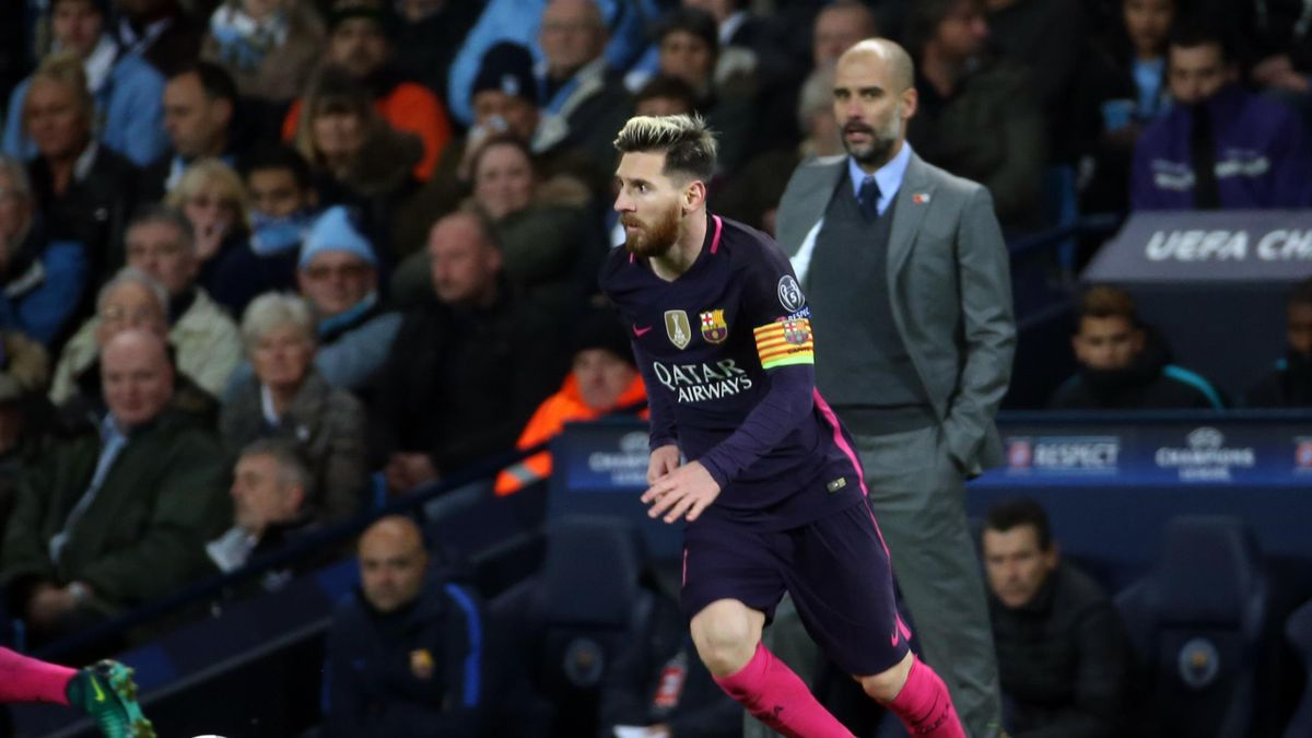Manchester City v Barcelona, UEFA Champions League, Group C, Etihad Stadium, Manchester City manager Pep Guardiola watches Barcelona's Lionel Messi