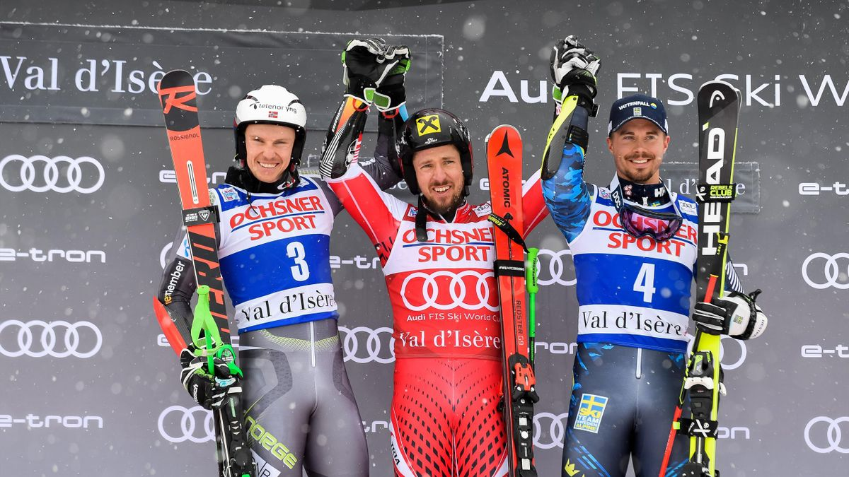 Henrik Kristoffersen of Norway takes 2nd place, Marcel Hirscher of Austria takes 1st place, Matts Olsson of Sweden takes 3rd place during the Audi FIS Alpine Ski World Cup Men's Giant Slalom on December 8, 2018 in Val d'Isère