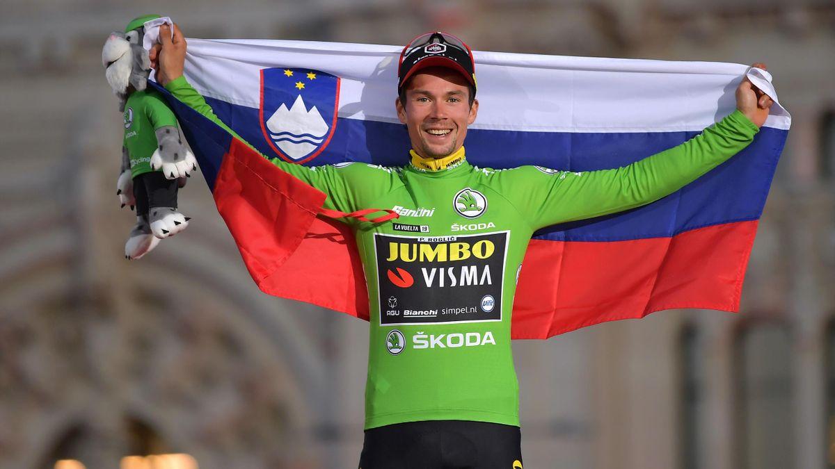 Primoz Roglic celebrates on the podium after winning the 2019 Vuelta
