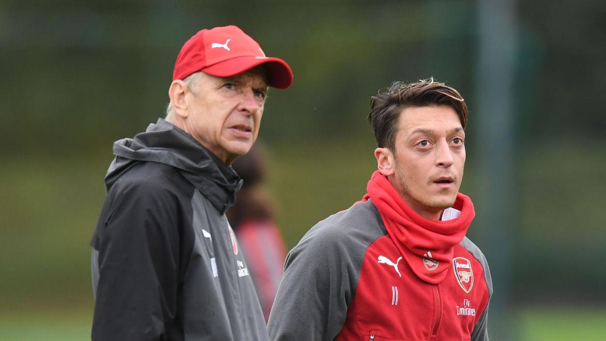Arsene Wenger (L) and Mesut Ozil (R)