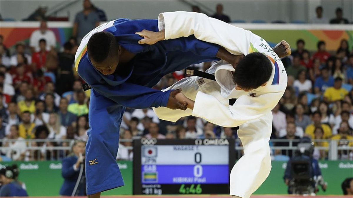 Japan's Takanori Nagase (white) competes with Gabon's Paul Kibikai during their men's -81kg judo contest match of the Rio 2016 Olympic Games in Rio de Janeiro on August 9, 2016. / AFP / Jack GUEZ (Photo credit should read JACK GUEZ/AFP via Getty Images)