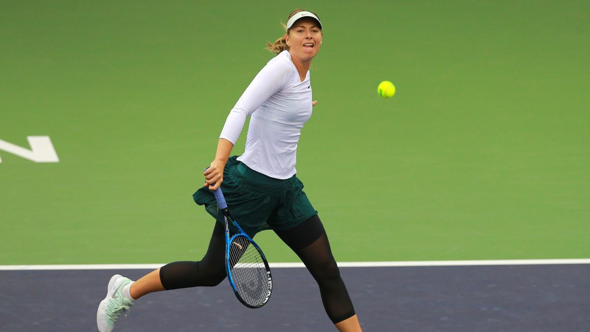 Maria Sharapova of Russia hits a return against Peng Shuai of China during their women's singles semi-final match at the WTA Tianjin Open tennis tournament in Tianjin on October 14, 2017
