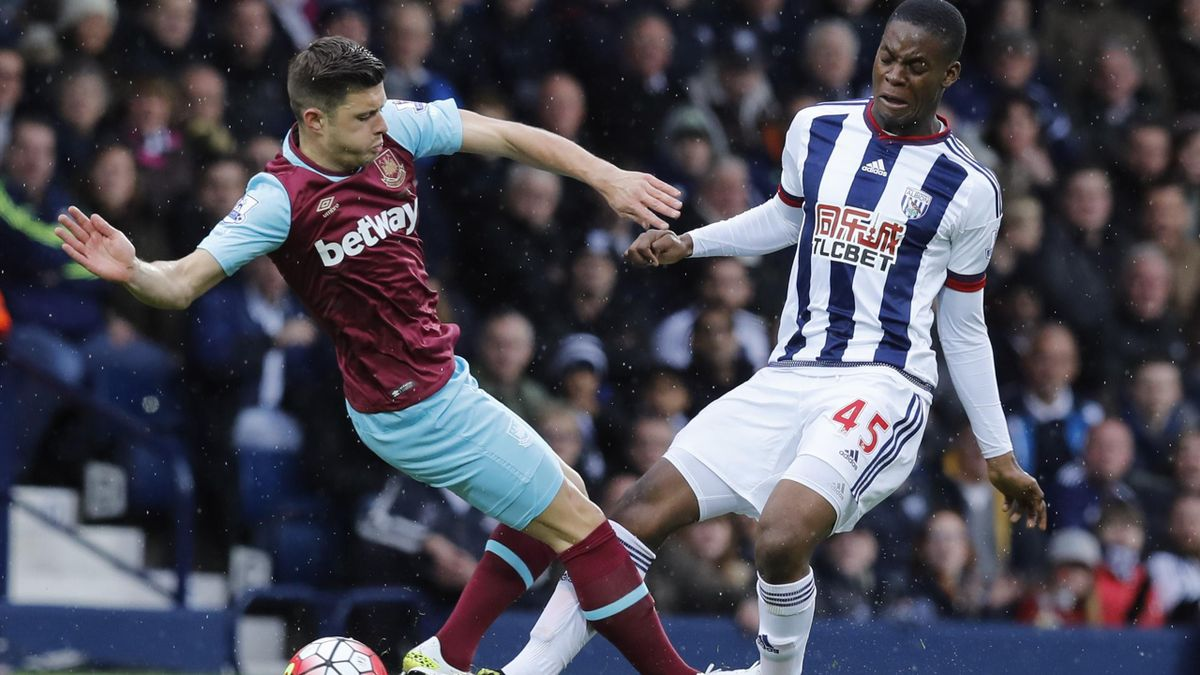 West Bromwich Albion's Jonathan Leko in action with West Ham United's Aaron Cresswell
