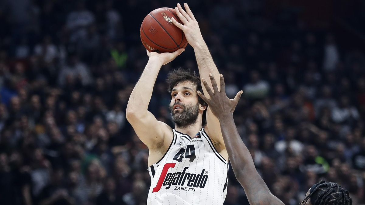 Milos Teodosic (L) of Virtus Bologna in action against Rashawn Thomas (R) of Partizan