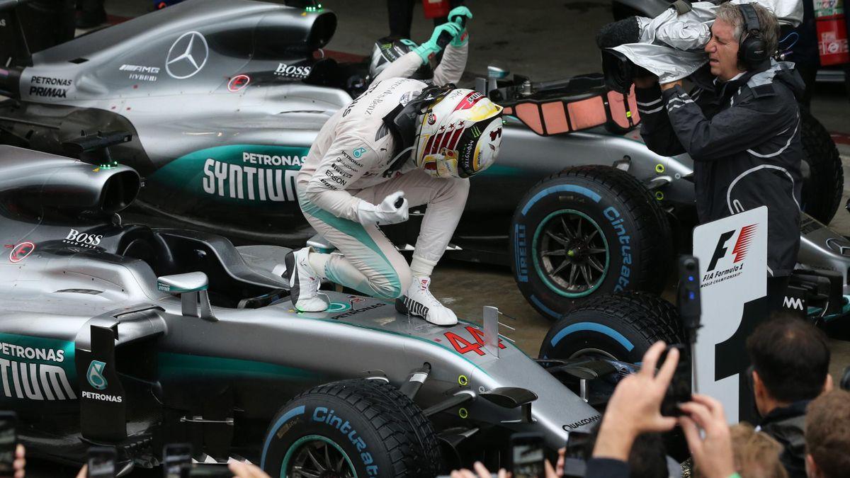 Lewis Hamilton celebrates his win in Interlagos