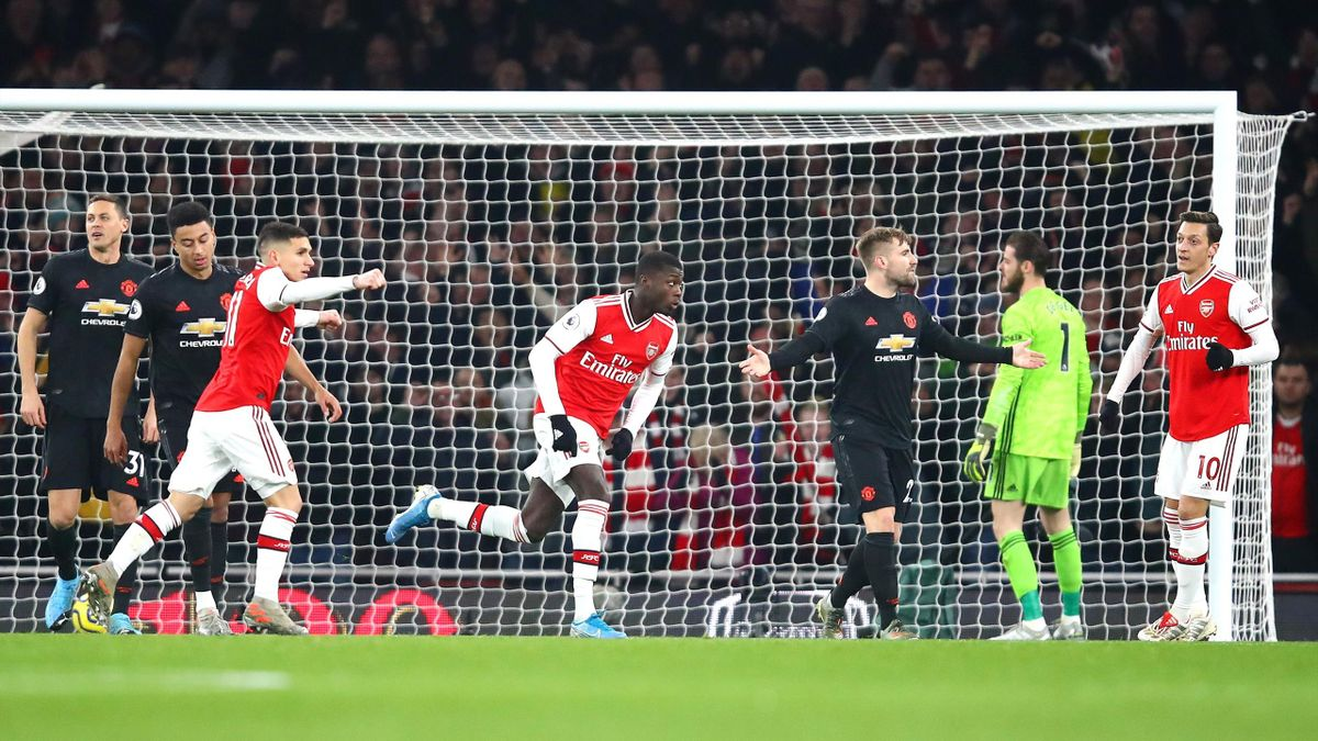 Nicolas Pepe of Arsenal celebrates after scoring his team's first goal during the Premier League match between Arsenal and Manchester United at Emirates Stadium