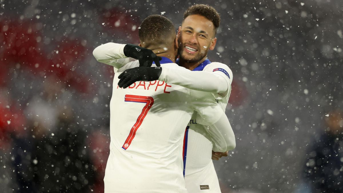 Kylian Mbappe of Paris Saint-Germain celebrates with team mate Neymar (R) after scoring their side's first goal during the UEFA Champions League Quarter Final match between FC Bayern Munich and Paris Saint-Germain at Allianz Arena on April 07, 2021 in Mun