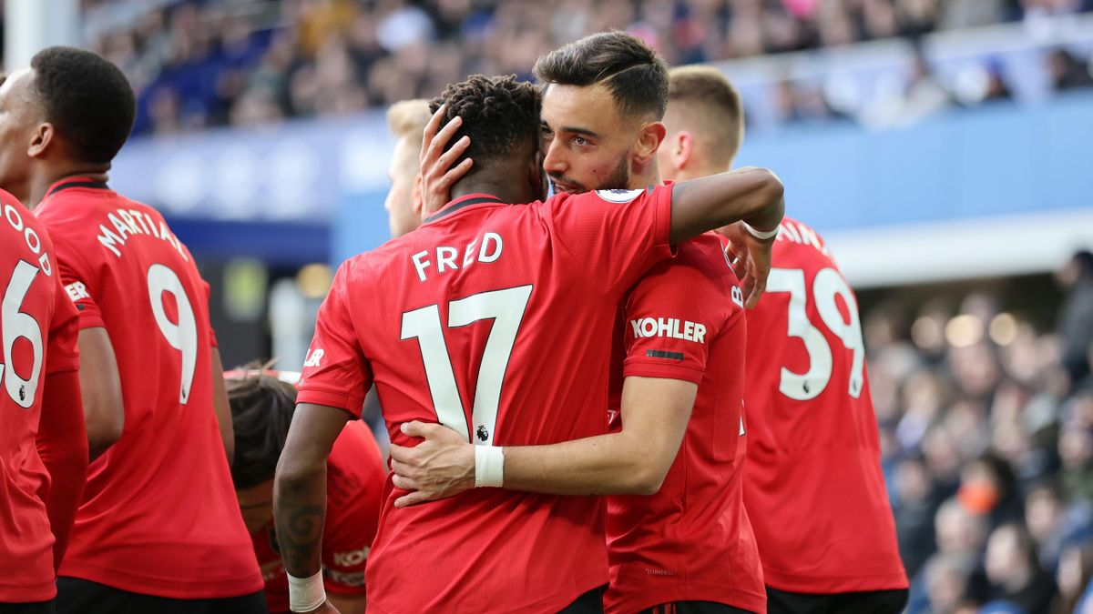 Bruno Fernandes of Manchester United celebrates with teammate Fred after scoring his team's first goal during the Premier League match between Everton FC and Manchester United