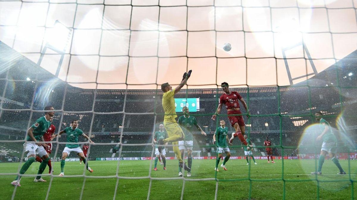 Jiri Pavlenka of SV Werder Bremen saves a header from Benjamin Pavard of Bayern Munich during the Bundesliga match between SV Werder Bremen and FC Bayern Muenchen at Wohninvest Weserstadion on June 16, 2020