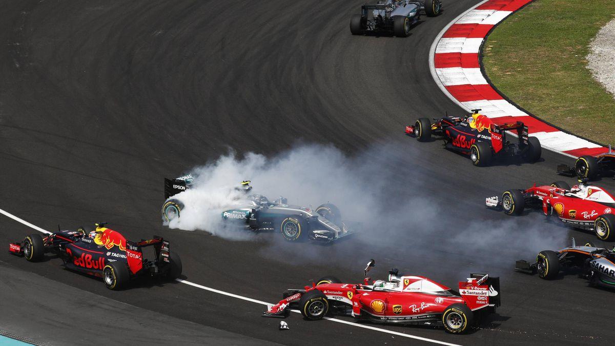 Sebastian Vettel (Ferrari), Nico Rosberg (Mercedes)