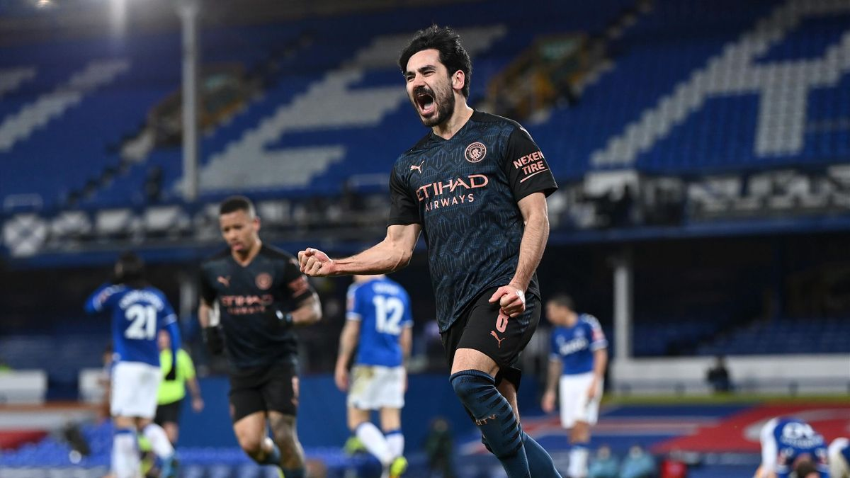 Ilkay Guendogan of Manchester City celebrates after scoring their side's first goal during The Emirates FA Cup Quarter Final match between Everton v Manchester City at Goodison Park on March 20, 2021 in Liverpool
