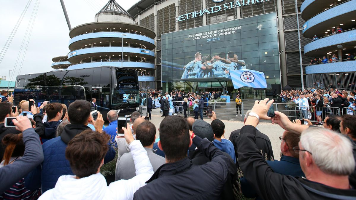 Man City fans watch the team arrive during the Premier League match between Manchester City and Huddersfield Town at Etihad Stadium on August 19, 2018 in Manchester, United Kingdom.
