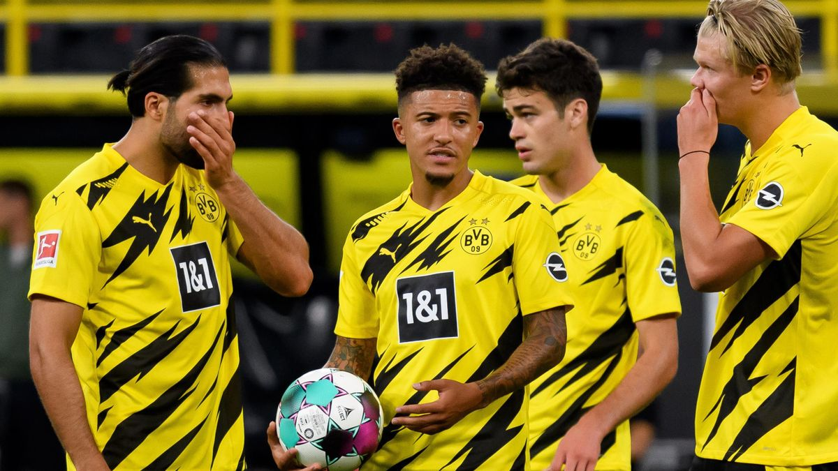 Jadon Sancho of Borussia Dortmund speaks with Erling Haaland of Borussia Dortmund who takes the penalty during the Bundesliga match between Borussia Dortmund and Borussia Moenchengladbach at Signal Iduna Park on September 19, 2020