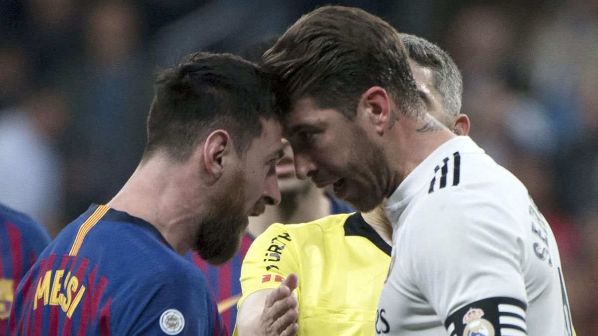 Barcelona's Argentinian forward Lionel Messi (L) argues with Real Madrid's Spanish defender Sergio Ramos during the Spanish league football match between Real Madrid CF and FC Barcelona at the Santiago Bernabeu stadium in Madrid on March 2, 2019. (Photo b
