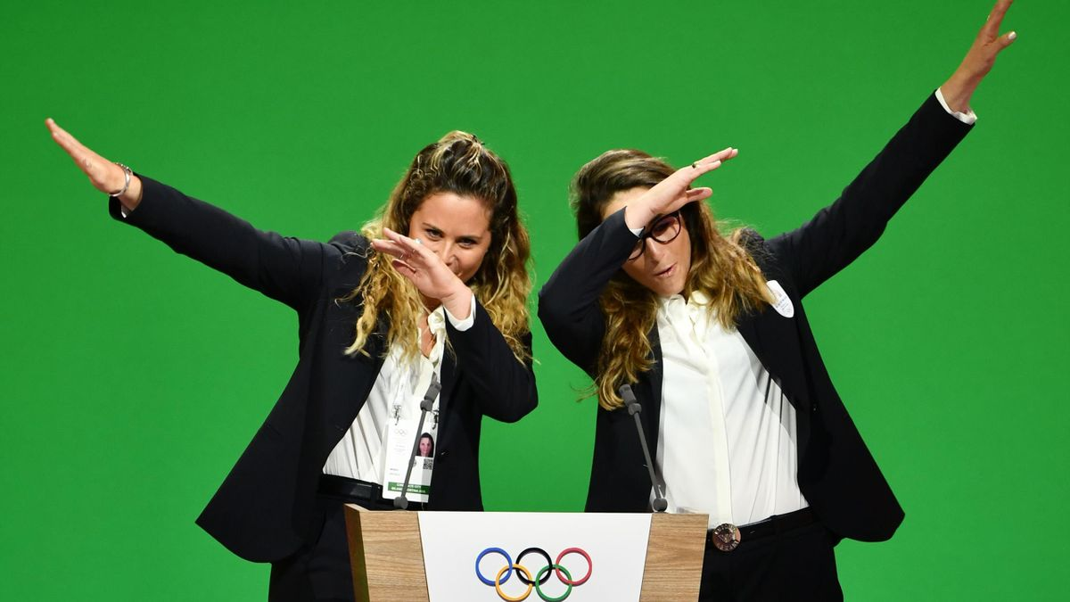 Italian Olympic champions Michela Moioli (L) and Sofia Goggia gestures on stage during the Milan/Cortina d'Ampezzo candidature committee's final presentation before the 134th session of the International Olympic Committee (IOC) held to decide which of Sto