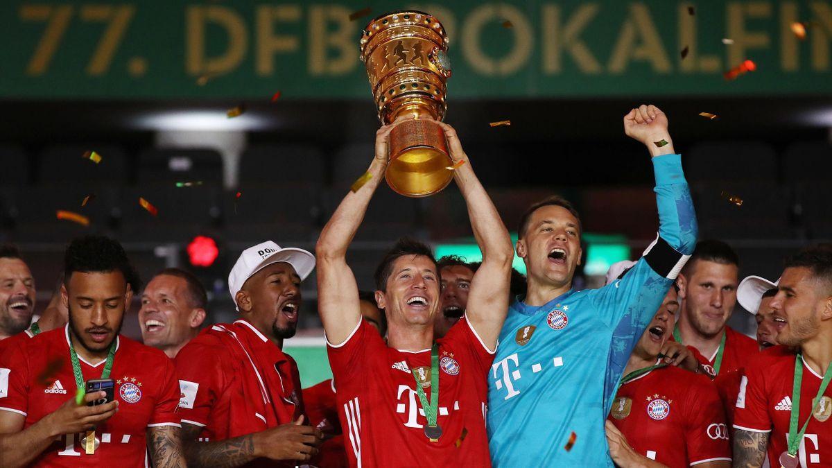 Robert Lewandowski raises the German Cup (DFB Pokal) trophy as he and his teammates celebrate winning the final football match Bayer 04 Leverkusen v FC Bayern Munich