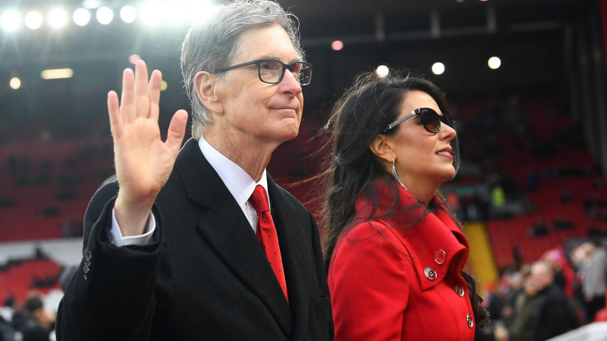 Liverpool owner John W. Henry and wife, Linda Pizzuti walk on the pitch prior to the Premier League match between Liverpool FC and Huddersfield Town